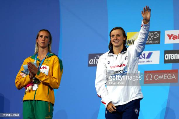 Silver medalists Emma Mckeon of Australia and Katie Ledecky of the United States pose with the medals won during the Women's 200m Freestyle final on...