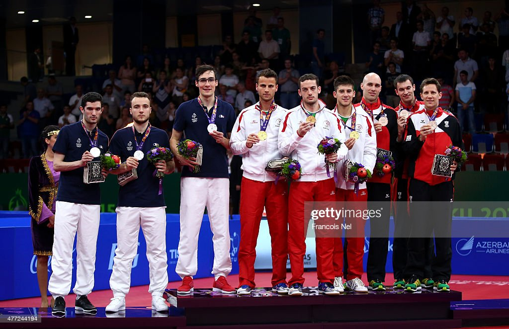 Silver medalists Emmanuel Lebesson, Simon Gauzy and <a gi-track='captionPersonalityLinkClicked' href=/galleries/search?phrase=Adrien+Mattenet&family=editorial&specificpeople=4212096 ng-click='$event.stopPropagation()'>Adrien Mattenet</a> of France, gold medalists <a gi-track='captionPersonalityLinkClicked' href=/galleries/search?phrase=Tiago+Apolonia&family=editorial&specificpeople=2523031 ng-click='$event.stopPropagation()'>Tiago Apolonia</a>, <a gi-track='captionPersonalityLinkClicked' href=/galleries/search?phrase=Marcos+Freitas&family=editorial&specificpeople=5835772 ng-click='$event.stopPropagation()'>Marcos Freitas</a> and Joao Geraldo of Portugal and bronze medalists Daniel Habesohn, Stefan Fegerl and <a gi-track='captionPersonalityLinkClicked' href=/galleries/search?phrase=Robert+Gardos&family=editorial&specificpeople=2160529 ng-click='$event.stopPropagation()'>Robert Gardos</a> of Austria pose during the medal ceremony for Men's Table Tennis Team Final on day three of the Baku 2015 European Games at Baku Sports Hall on June 15, 2015 in Baku, Azerbaijan.