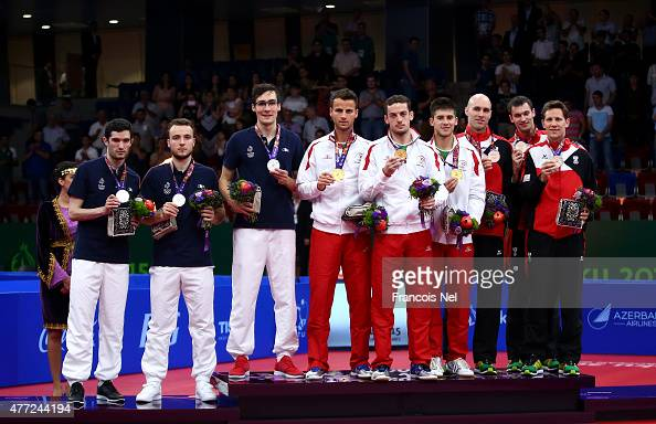 Silver medalists Emmanuel Lebesson Simon Gauzy and Adrien Mattenet of France gold medalists Tiago Apolonia Marcos Freitas and Joao Geraldo of...