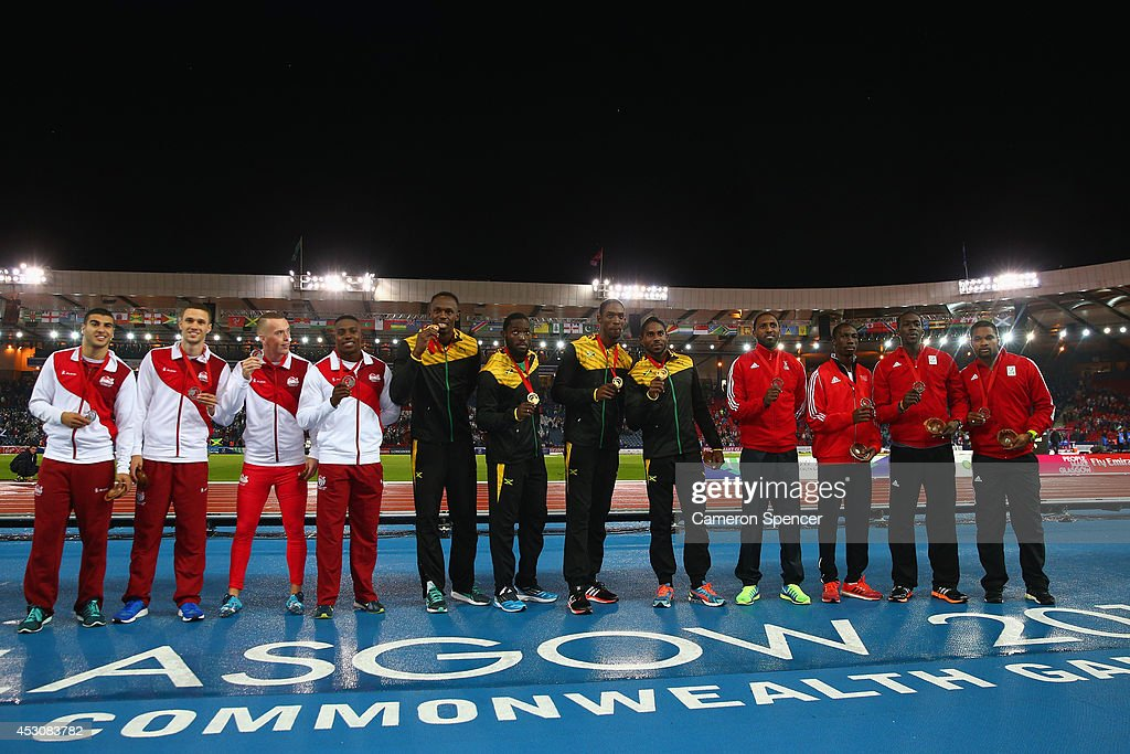 Silver medalists England, gold medalists Jamaica and bronze medalists Trinidad and Tobago pose during the medal ceremony for the Men's 4x100 metres relay at Hampden Park during day ten of the Glasgow 2014 Commonwealth Games on August 2, 2014 in Glasgow, United Kingdom.