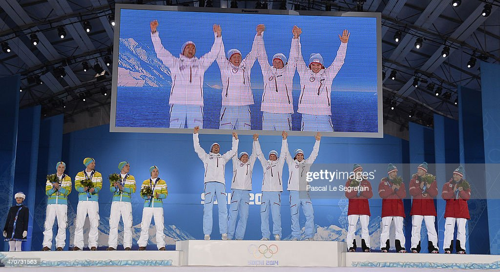 Silver medalists <a gi-track='captionPersonalityLinkClicked' href=/galleries/search?phrase=Eric+Frenzel&family=editorial&specificpeople=4595984 ng-click='$event.stopPropagation()'>Eric Frenzel</a>, Bjoern Kircheisen, <a gi-track='captionPersonalityLinkClicked' href=/galleries/search?phrase=Johannes+Rydzek&family=editorial&specificpeople=5667838 ng-click='$event.stopPropagation()'>Johannes Rydzek</a> and <a gi-track='captionPersonalityLinkClicked' href=/galleries/search?phrase=Fabian+Riessle&family=editorial&specificpeople=6479574 ng-click='$event.stopPropagation()'>Fabian Riessle</a> of Germany, Gold medalists Magnus Hovdal Moan, Haavard Klemetsen, <a gi-track='captionPersonalityLinkClicked' href=/galleries/search?phrase=Magnus+Krog&family=editorial&specificpeople=8672843 ng-click='$event.stopPropagation()'>Magnus Krog</a> and Joergen Graabak of Norway, and bronze medalists <a gi-track='captionPersonalityLinkClicked' href=/galleries/search?phrase=Lukas+Klapfer&family=editorial&specificpeople=5744499 ng-click='$event.stopPropagation()'>Lukas Klapfer</a>, <a gi-track='captionPersonalityLinkClicked' href=/galleries/search?phrase=Bernhard+Gruber&family=editorial&specificpeople=824521 ng-click='$event.stopPropagation()'>Bernhard Gruber</a>, <a gi-track='captionPersonalityLinkClicked' href=/galleries/search?phrase=Mario+Stecher&family=editorial&specificpeople=724611 ng-click='$event.stopPropagation()'>Mario Stecher</a> and <a gi-track='captionPersonalityLinkClicked' href=/galleries/search?phrase=Christoph+Bieler&family=editorial&specificpeople=724610 ng-click='$event.stopPropagation()'>Christoph Bieler</a> of Austria celebrate on the podium during the medal ceremony for the Nordic Combined Team Large Hill / 4 x 5 km on day thirteen of the Sochi 2014 Winter Olympics at at Medals Plaza on February 20, 2014 in Sochi, Russia.