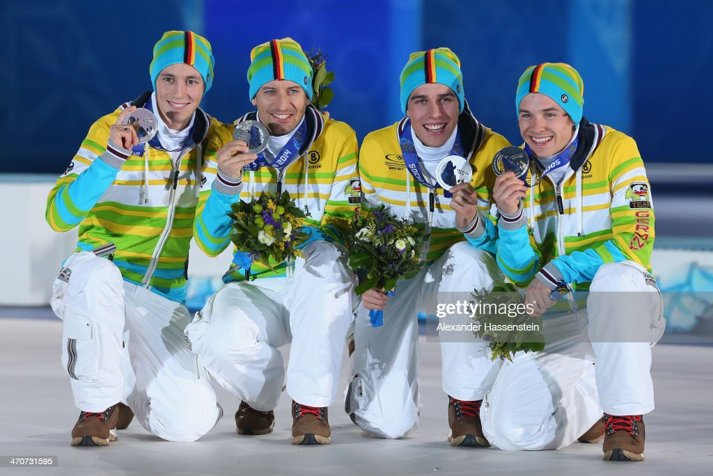 Silver medalists Eric Frenzel, <a gi-track='captionPersonalityLinkClicked' href=/galleries/search?phrase=Bjoern+Kircheisen&family=editorial&specificpeople=726172 ng-click='$event.stopPropagation()'>Bjoern Kircheisen</a>, <a gi-track='captionPersonalityLinkClicked' href=/galleries/search?phrase=Johannes+Rydzek&family=editorial&specificpeople=5667838 ng-click='$event.stopPropagation()'>Johannes Rydzek</a> and <a gi-track='captionPersonalityLinkClicked' href=/galleries/search?phrase=Fabian+Riessle&family=editorial&specificpeople=6479574 ng-click='$event.stopPropagation()'>Fabian Riessle</a> of Germany celebrate during the medal ceremony for the Nordic Combined Team Large Hill / 4 x 5 km on day thirteen of the Sochi 2014 Winter Olympics at at Medals Plaza on February 20, 2014 in Sochi, Russia.