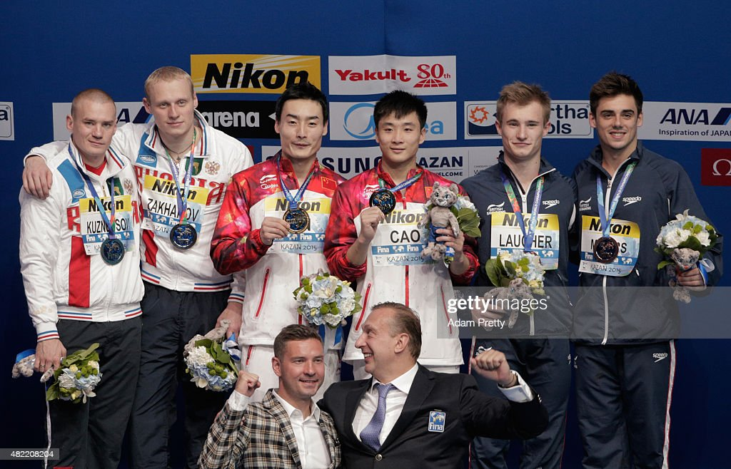 Silver medalists Evgenii Kuznetsov and Ilia Zakharov of Russia, gold medallists Yuan Cao and <a gi-track='captionPersonalityLinkClicked' href=/galleries/search?phrase=Kai+Qin&family=editorial&specificpeople=4198000 ng-click='$event.stopPropagation()'>Kai Qin</a> of China and bronze medalists <a gi-track='captionPersonalityLinkClicked' href=/galleries/search?phrase=Jack+Laugher&family=editorial&specificpeople=6929436 ng-click='$event.stopPropagation()'>Jack Laugher</a> and <a gi-track='captionPersonalityLinkClicked' href=/galleries/search?phrase=Chris+Mears+-+Diver&family=editorial&specificpeople=9624762 ng-click='$event.stopPropagation()'>Chris Mears</a> of Great Britain pose during the medal ceremony for the in the Men's 3m Springboard Synchronised Diving Final on day four of the 16th FINA World Championships at the Aquatics Palace on July 28, 2015 in Kazan, Russia.