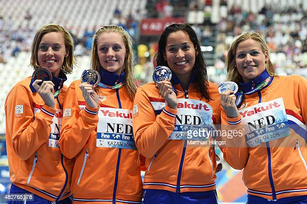 Silver medalists Femke Heemskerk Marrit Steenbergen Ranomi Kromowidjojo and Maud van der Meer of the Netherlands pose during the medal ceremony for...