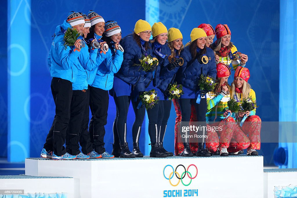 Silver medalists Finland, gold medalists Sweden and bronze medalists Germany celebrate on the podium during the medal ceremony for the Women's 4 x 5 km Relay on day 9 of the Sochi 2014 Winter Olympics at Medals Plaza on February 16, 2014 in Sochi, Russia.