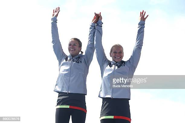 Silver medalists Franzi Weber and Tina Dietze of Germany celebrate on the podium after competing during the Women's Kayak Double 500m Final A on Day...