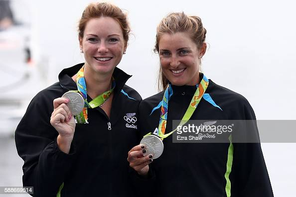 Silver medalists Genevieve Behrent and Rebecca Scown of New Zealand celebrate after the medal ceremony for the Women's Pair on Day 7 of the Rio 2016...