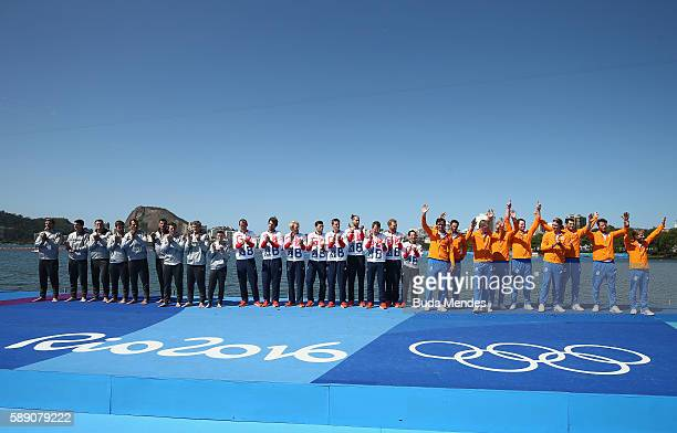 Silver medalists Germany gold medalists Great Britain and bronze medalists Netherlands celebrate on the podium at the medal ceremony for the Men's...