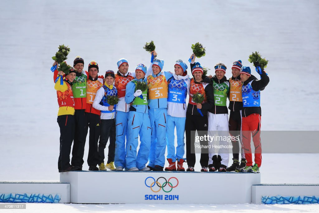 Silver medalists Germany, gold medalists Norway and bronze medalists Austria celebrate during the flower ceremony for the Nordic Combined Men's Team 4 x 5 km during day 13 of the Sochi 2014 Winter Olympics at RusSki Gorki Jumping Center on February 20, 2014 in Sochi, Russia.