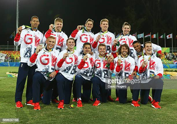 Silver medalists Great Britain pose during the medal ceremony for the Men's Rugby Sevens on Day 6 of the Rio 2016 Olympics at Deodoro Stadium on...