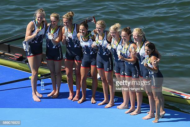 Silver medalists Great Britain pose for photographs after the medal ceremony for the Women's Eight on Day 8 of the Rio 2016 Olympic Games at the...