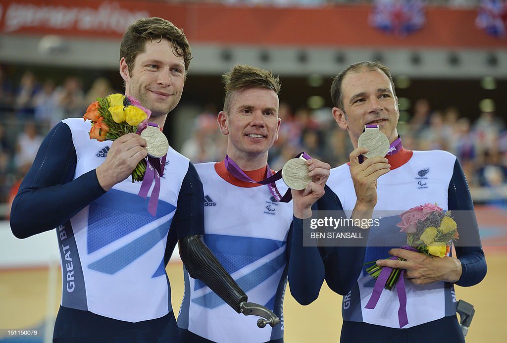 Silver medalists Great Britain's Darren Kenny Richard Waddon and JonAllan Butterworth pose with their medals following the Mixed C1 to 5 Cycling Team...
