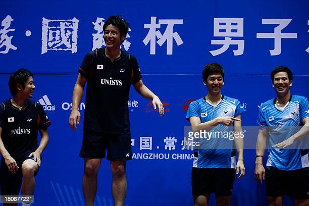 Silver medalists Hiroyuki Endo and Kenichi Hayakawa of Japan gold medalists Yong Dae Lee and Sung Hyun Ko of South Korea pose on the podium after the...