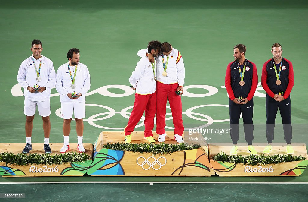 Silver medalists Horia Tecau and Florin Mergea of Romania, gold medalists Rafael Nadal and Marc Lopez of Spain, and bronze medalists Steve Johnson and Jack Sock of the United States stand on the podium after the Men's Doubles competition on Day 7 of the Rio 2016 Olympic Games at the Olympic Tennis Centre on August 12, 2016 in Rio de Janeiro, Brazil.