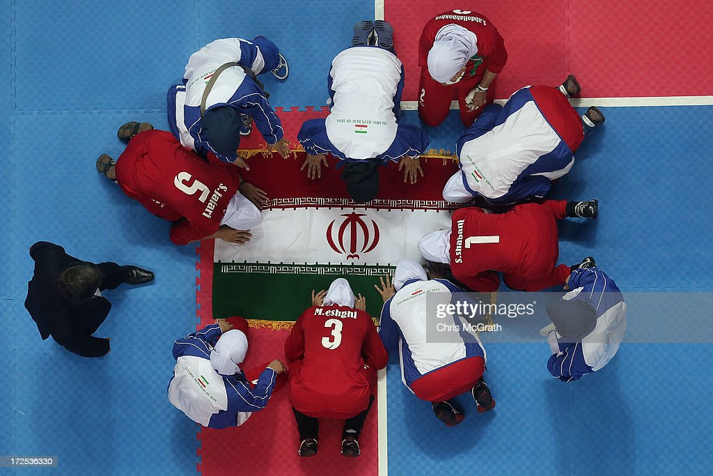 Silver medalists, Iran pray after being defeated by the Independent Olympic Athletes during the Women's Kabaddi Gold Medal match at Ansan Sangnoksu Gym on day five of the 4th Asian Indoor & Martial Arts Games on July 3, 2013 in Incheon, South Korea.