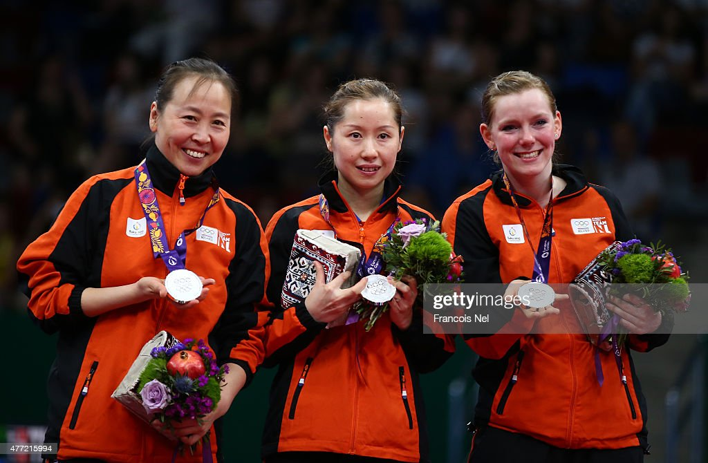 Silver medalists Jiao Li, Jie Li and Britt Eerland of Netherlands pose with the medals won in the Women's Team Table Tennis finals during day three of the Baku 2015 European Games at Baku Sports Hall on June 15, 2015 in Baku, Azerbaijan.