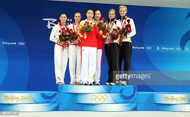 Silver medalists Julia Pakhalina and Anastasia Pozdnyakova of Russia gold medalists Guo Jingjing and Wu Minxia of China and bronze medalists Ditte...