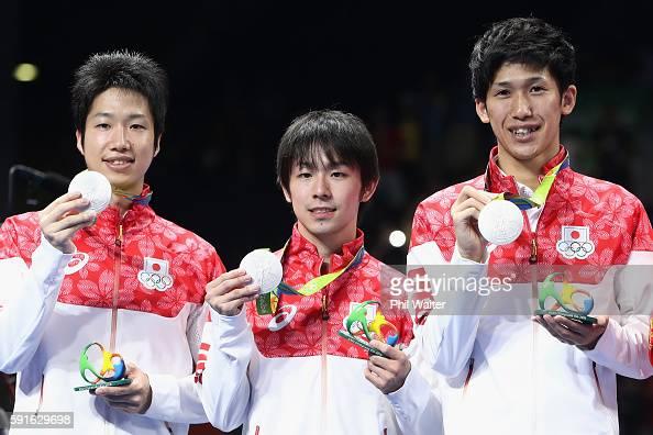 Silver medalists Jun Mizutani Maharu Yoshimura and Koki Niwa of Japan celebrate during the medal ceremony after the Men's Team Table Tennis gold...