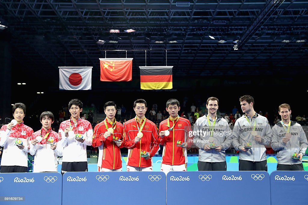 Silver medalists Jun Mizutani, Maharu Yoshimura and Koki Niwa of Japan, gold medalists Long Ma, Xin Xu, and Jike Zhang of China and bronze medalists Timo Boll, Dimitrij Ovtcharov, and Bastian Steger of Germany celebrate during the Men's Team Table Tennis medal ceremony on Day 12 of the Rio 2016 Olympic Games at Riocentro - Pavilion 3 on August 17, 2016 in Rio de Janeiro, Brazil.