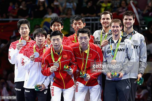Silver medalists Jun Mizutani Maharu Yoshimura and Koki Niwa of Japan gold medalists Long Ma Xin Xu and Jike Zhang of China and bronze medalists Timo...