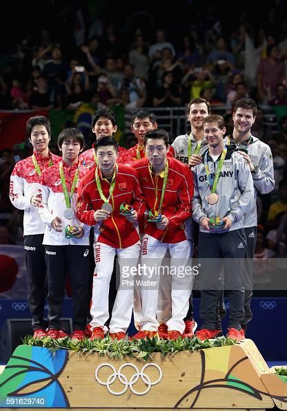 Silver medalists Jun Mizutani Maharu Yoshimura and Koki Niwa of Japan gold medalists Long Ma Xin Xu and Jike Zhang of China and bronze medalists Timo...