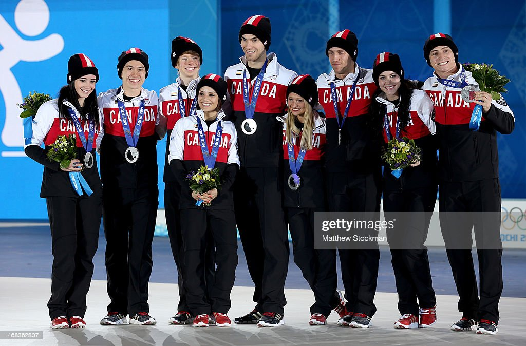 Silver medalists <a gi-track='captionPersonalityLinkClicked' href=/galleries/search?phrase=Kaetlyn+Osmond&family=editorial&specificpeople=9891099 ng-click='$event.stopPropagation()'>Kaetlyn Osmond</a>, <a gi-track='captionPersonalityLinkClicked' href=/galleries/search?phrase=Patrick+Chan&family=editorial&specificpeople=4036503 ng-click='$event.stopPropagation()'>Patrick Chan</a>, <a gi-track='captionPersonalityLinkClicked' href=/galleries/search?phrase=Kevin+Reynolds&family=editorial&specificpeople=5578771 ng-click='$event.stopPropagation()'>Kevin Reynolds</a>, <a gi-track='captionPersonalityLinkClicked' href=/galleries/search?phrase=Meagan+Duhamel&family=editorial&specificpeople=2076875 ng-click='$event.stopPropagation()'>Meagan Duhamel</a>, <a gi-track='captionPersonalityLinkClicked' href=/galleries/search?phrase=Eric+Radford&family=editorial&specificpeople=5587908 ng-click='$event.stopPropagation()'>Eric Radford</a>, <a gi-track='captionPersonalityLinkClicked' href=/galleries/search?phrase=Kirsten+Moore-Towers&family=editorial&specificpeople=7301059 ng-click='$event.stopPropagation()'>Kirsten Moore-Towers</a>, <a gi-track='captionPersonalityLinkClicked' href=/galleries/search?phrase=Dylan+Moscovitch&family=editorial&specificpeople=7301055 ng-click='$event.stopPropagation()'>Dylan Moscovitch</a>, <a gi-track='captionPersonalityLinkClicked' href=/galleries/search?phrase=Tessa+Virtue&family=editorial&specificpeople=793314 ng-click='$event.stopPropagation()'>Tessa Virtue</a> and <a gi-track='captionPersonalityLinkClicked' href=/galleries/search?phrase=Scott+Moir&family=editorial&specificpeople=793313 ng-click='$event.stopPropagation()'>Scott Moir</a> of Canada celebrate during the medal ceremony for the Team Figure Skating Overall on day 3 of the Sochi 2014 Winter Olympics at Medals Plaza in the Olympic Park on February 10, 2014 in Sochi, Russia.