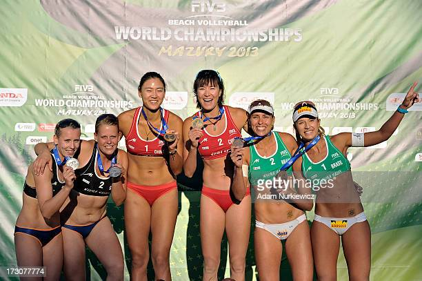Silver medalists Karla Borger and Britta Buthe of Germany gold medalists Chen Xue and Xi Zhang of China and bronze medalists Liliane Maestrini and...
