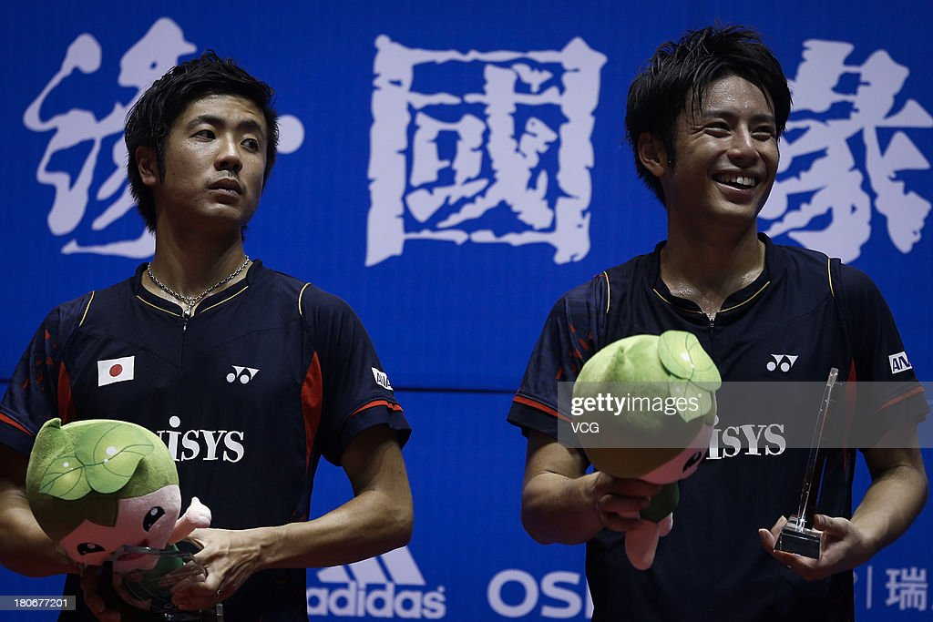 Silver medalists <a gi-track='captionPersonalityLinkClicked' href=/galleries/search?phrase=Kenichi+Hayakawa&family=editorial&specificpeople=5851276 ng-click='$event.stopPropagation()'>Kenichi Hayakawa</a> and <a gi-track='captionPersonalityLinkClicked' href=/galleries/search?phrase=Hiroyuki+Endo&family=editorial&specificpeople=5530229 ng-click='$event.stopPropagation()'>Hiroyuki Endo</a> (L) of Japan pose on the podium after losing the men's doubles final match against Yong Dae Lee and Sung Hyun Ko of South Korea on day 6 of the 2013 China Badminton Masters at Changzhou Olympic Sports Center on September 15, 2013 in Changzhou, China.