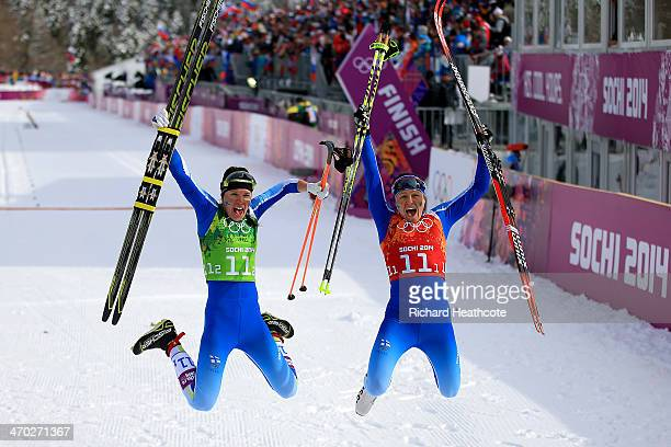 Silver medalists Kerttu Niskanen of Finland and AinoKaisa Saarinen of Finland celebrate after the Women's Team Sprint Classic Final during day 12 of...