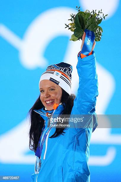 Silver medalists Kerttu Niskanen of Finland celebrates on the podium during the medal ceremony for the Women's 4 x 5 km Relay on day 9 of the Sochi...