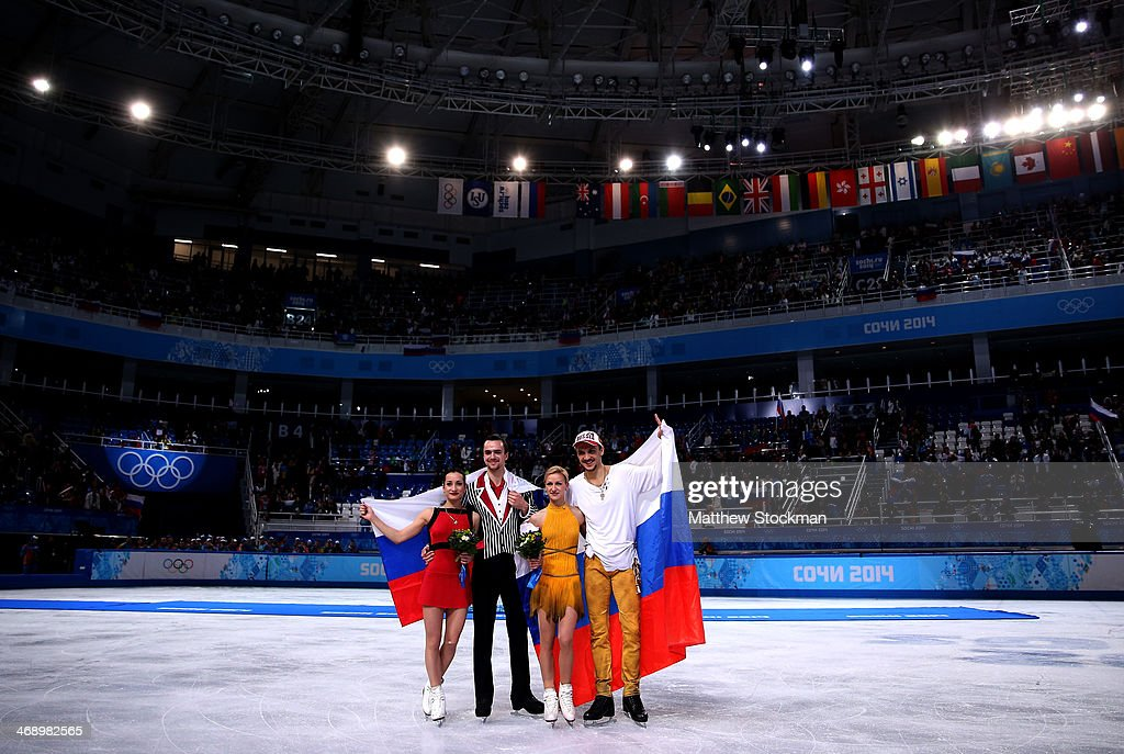 Silver medalists <a gi-track='captionPersonalityLinkClicked' href=/galleries/search?phrase=Ksenia+Stolbova&family=editorial&specificpeople=7338286 ng-click='$event.stopPropagation()'>Ksenia Stolbova</a> and <a gi-track='captionPersonalityLinkClicked' href=/galleries/search?phrase=Fedor+Klimov&family=editorial&specificpeople=7338285 ng-click='$event.stopPropagation()'>Fedor Klimov</a> of Russia, gold medalists <a gi-track='captionPersonalityLinkClicked' href=/galleries/search?phrase=Tatiana+Volosozhar&family=editorial&specificpeople=798077 ng-click='$event.stopPropagation()'>Tatiana Volosozhar</a> and <a gi-track='captionPersonalityLinkClicked' href=/galleries/search?phrase=Maxim+Trankov&family=editorial&specificpeople=798054 ng-click='$event.stopPropagation()'>Maxim Trankov</a> of Russia pose during the flower ceremony for the Figure Skating Pairs event during day five of the 2014 Sochi Olympics at Iceberg Skating Palace on February 12, 2014 in Sochi, Russia.