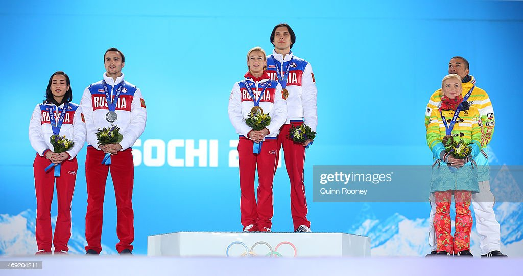 Silver medalists <a gi-track='captionPersonalityLinkClicked' href=/galleries/search?phrase=Ksenia+Stolbova&family=editorial&specificpeople=7338286 ng-click='$event.stopPropagation()'>Ksenia Stolbova</a> and <a gi-track='captionPersonalityLinkClicked' href=/galleries/search?phrase=Fedor+Klimov&family=editorial&specificpeople=7338285 ng-click='$event.stopPropagation()'>Fedor Klimov</a> of Russia, gold medalists <a gi-track='captionPersonalityLinkClicked' href=/galleries/search?phrase=Tatiana+Volosozhar&family=editorial&specificpeople=798077 ng-click='$event.stopPropagation()'>Tatiana Volosozhar</a> and <a gi-track='captionPersonalityLinkClicked' href=/galleries/search?phrase=Maxim+Trankov&family=editorial&specificpeople=798054 ng-click='$event.stopPropagation()'>Maxim Trankov</a> of Russia, bronze medalists <a gi-track='captionPersonalityLinkClicked' href=/galleries/search?phrase=Aliona+Savchenko&family=editorial&specificpeople=247200 ng-click='$event.stopPropagation()'>Aliona Savchenko</a> and <a gi-track='captionPersonalityLinkClicked' href=/galleries/search?phrase=Robin+Szolkowy&family=editorial&specificpeople=247243 ng-click='$event.stopPropagation()'>Robin Szolkowy</a> of Germany during the medal ceremony for the Figure Skating Pairs Free Skating on day six of the Sochi 2014 Winter Olympics at Medals Plaza on February 13, 2014 in Sochi, Russia.