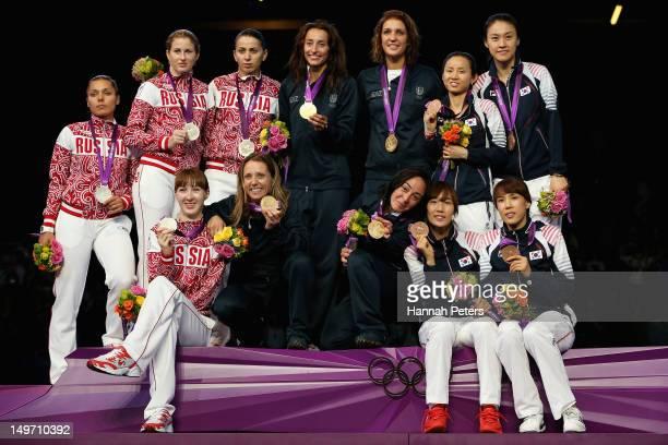 Silver medalists Larisa Korobeynikova Aida Shanaeva Inna Deriglazova and Kamilla Gafurzianova of Russia gold medalists Ilaria Salvatori Arianna...