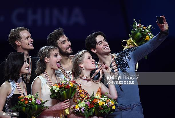 Silver medalists Madison Chock and Evan Bates of the US gold medalists Gabriella Papadakis and Guillaume Cizeron of France and bronze medalists...