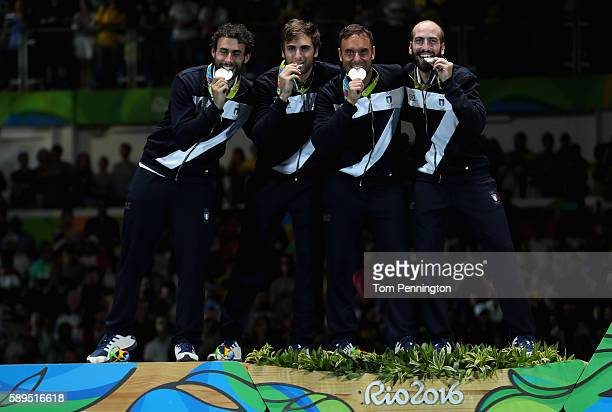 Silver medalists Marco Fichera Enrico Garozzo Paolo Pizzo and Andrea Santarelli of Italy pose on the podium during the medal ceremony for the Men's...
