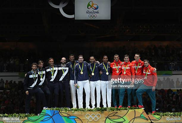 Silver medalists Marco Fichera Enrico Garozzo Paolo Pizzo and Andrea Santarelli of Italy gold medalists Yannick Borel Gauthier Grumier Daniel Jerent...