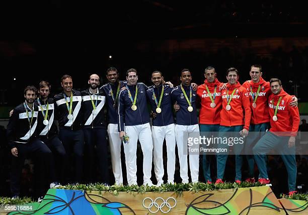 Silver medalists Marco Fichera Enrico Garozzo Paolo Pizzo and Andrea Santarelli of Italy gold medalists Yannick Borel Gauthier Grumier Daniel Jerent...