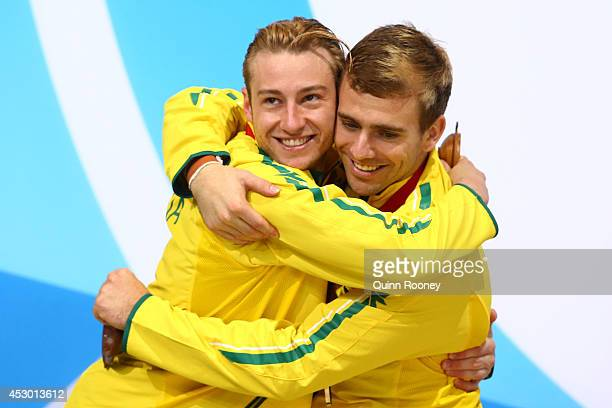 Silver medalists Matthew Mitcham and Grant Nel of Australia celebrate during the medal ceremony for the Men's Synchronised 3m Springboard Final at...