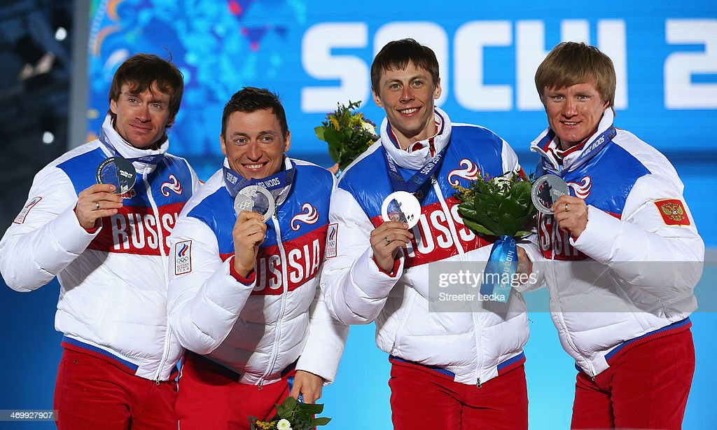 Silver medalists <a gi-track='captionPersonalityLinkClicked' href=/galleries/search?phrase=Maxim+Vylegzhanin&family=editorial&specificpeople=4779618 ng-click='$event.stopPropagation()'>Maxim Vylegzhanin</a>, <a gi-track='captionPersonalityLinkClicked' href=/galleries/search?phrase=Alexander+Legkov&family=editorial&specificpeople=4037875 ng-click='$event.stopPropagation()'>Alexander Legkov</a>, Alexander Bessmertnykh and Dmitriy Japarov of Russia celebrate on the podium during the medal ceremony for the Cross Country Men's 4 x 10 km Relay on day ten of the Sochi 2014 Winter Olympics at the Medals Plaza on February 17, 2014 in Sochi, Russia.