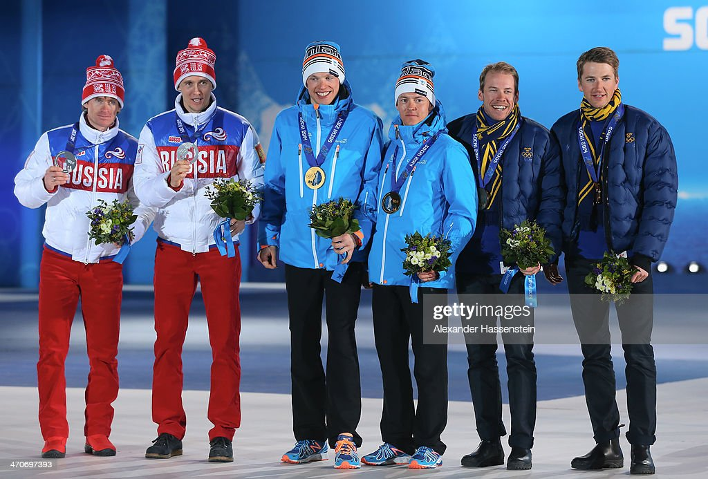 Silver medalists <a gi-track='captionPersonalityLinkClicked' href=/galleries/search?phrase=Maxim+Vylegzhanin&family=editorial&specificpeople=4779618 ng-click='$event.stopPropagation()'>Maxim Vylegzhanin</a> and <a gi-track='captionPersonalityLinkClicked' href=/galleries/search?phrase=Nikita+Kriukov&family=editorial&specificpeople=4907513 ng-click='$event.stopPropagation()'>Nikita Kriukov</a> of Russia, gold medalists <a gi-track='captionPersonalityLinkClicked' href=/galleries/search?phrase=Iivo+Niskanen&family=editorial&specificpeople=12444756 ng-click='$event.stopPropagation()'>Iivo Niskanen</a> and Sami Jauhojaervi of Finland and bronze medalists <a gi-track='captionPersonalityLinkClicked' href=/galleries/search?phrase=Teodor+Peterson&family=editorial&specificpeople=6567370 ng-click='$event.stopPropagation()'>Teodor Peterson</a> and <a gi-track='captionPersonalityLinkClicked' href=/galleries/search?phrase=Emil+Joensson&family=editorial&specificpeople=4045550 ng-click='$event.stopPropagation()'>Emil Joensson</a> of Sweden celebrate on the podium during the medal ceremony for the Cross Country Men's Team Sprint on day thirteen of the Sochi 2014 Winter Olympics at at Medals Plaza on February 20, 2014 in Sochi, Russia.
