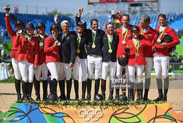Silver medalists McLain Ward of United States riding Azur Lucy Davis of United States riding Barron Kent Farrington of the United States riding...