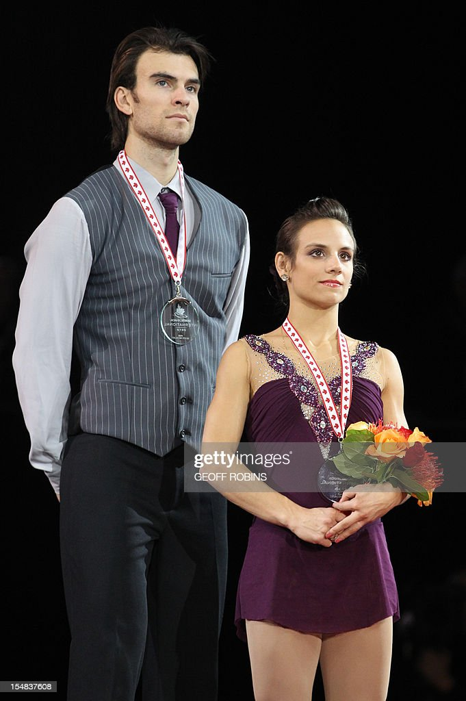 Silver medalists Meagan Duhamel and Eric Radford of Canada stand on the podium during the pairs medals ceremony at the 2012 Skate Canada International ISU Grand Prix event in Windsor on October 27, 2012. AFP PHOTO/Geoff Robins