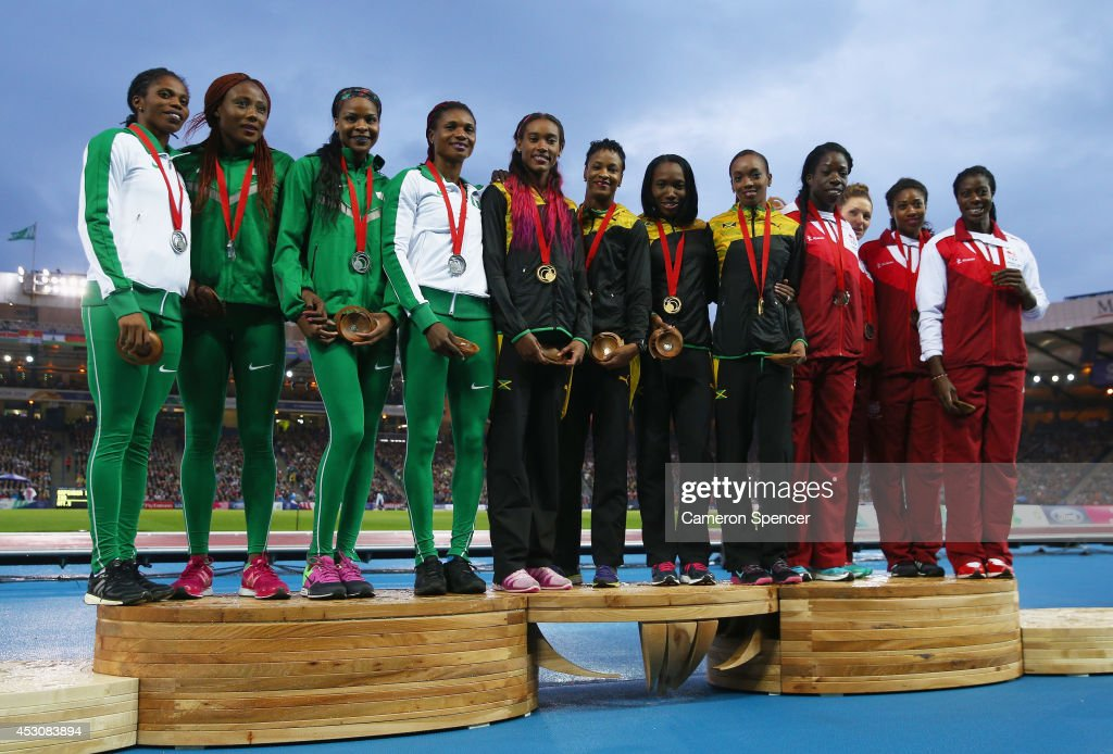 Silver medalists Nigeria, gold medalists Jamaica and bronze medalists England pose on the podium during the medal ceremony for the Women's 4x400 metres relay at Hampden Park during day ten of the Glasgow 2014 Commonwealth Games on August 2, 2014 in Glasgow, United Kingdom.