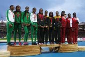Silver medalists Nigeria gold medalists Jamaica and bronze medalists England pose on the podium during the medal ceremony for the Women's 4x400...