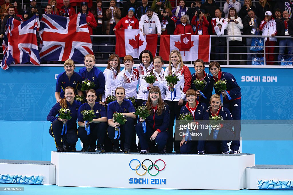 Silver medalists of Sweden gold medallists of Canada and bronze medalists of Great Britain celebrate during the flower ceremony for the Gold medal...