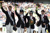 Silver medalists of the team classification Great Britain's William FoPitt Kristina Cook Zara Phillips and Harry Meade celebrate during the podium...