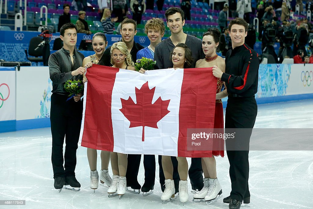 Silver medalists Patrick Chan, Kaetlyn Osmond, Kirsten Moore-Towers, Dylan Moscovitch, Kevin Reynolds, Eric Radford, Meagan Duhamel, Tessa Virtue and Scott Moir of Canada celebrate during the flower ceremony for the Team Figure Skating Overall during day two of the Sochi 2014 Winter Olympics at Iceberg Skating Palace onon February 9, 2014 in Sochi, Russia.