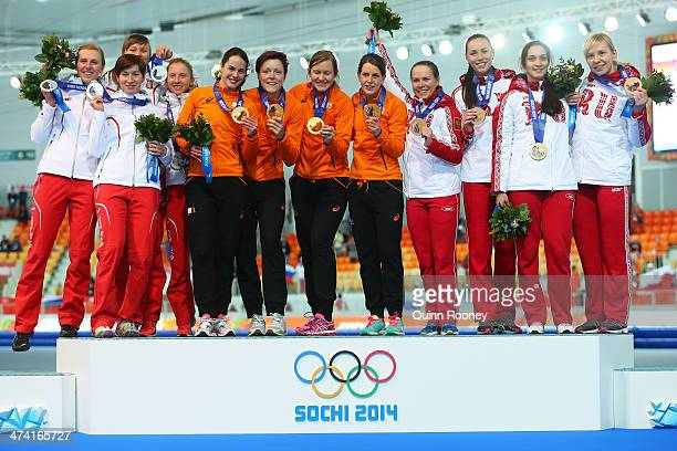 Silver medalists Poland gold medalists Netherlands and bronze medalists Russia celebrate on the podium during the medal ceremony for the Speed...