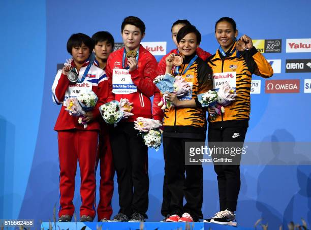 Silver medalists Rae Kim Mi and Kuk Hyang Kim of The Democratic People's Republic of Korea gold medalists Qian Ren and Yajie Si of China and bronze...