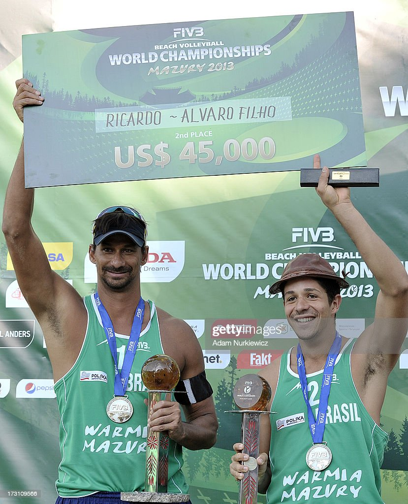 Silver medalists Ricardo Alex Costa Santos and Alvaro Morais Filho of Brazil celebrate during the medal ceremony during Day 7 of the FIVB World Championships on July 7, 2013 in Stare Jablonki, Poland.